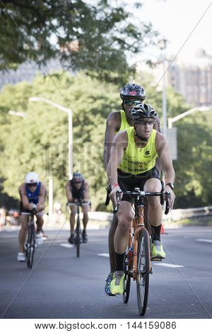 NEW YORK - JUL 24 2016: Achilles International ParaTriathletes compete in the Panasonic NYC Triathlon, biking 40 kilometers mainly on the Henry Hudson Parkway.