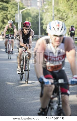 NEW YORK JUL 24 2016: Athletes compete in the Panasonic NYC Triathlon, biking 40 kilometers mainly on the Henry Hudson Parkway, in the only International Distance triathlon in New York City.