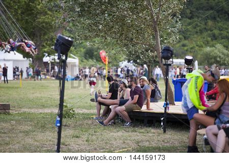 Bontida, Romania - July 14, 2016: Audience having fun before concert at Electric Castle festival, one of the biggest music festivals in Romania