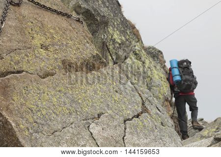 Poland Tatra Mountains Climber at Orla Perc Route (background) via ferrata chains foreground