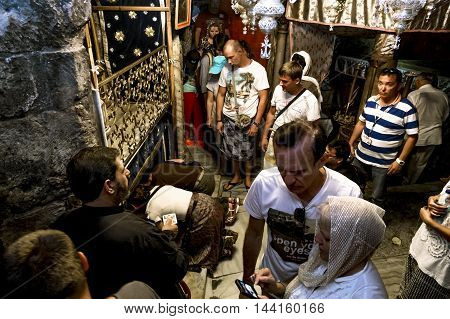 Sep 11 2014. Bethlehem. Pilgrims in the grotto of the Basilica of the Nativity in Bethlehem . Israel
