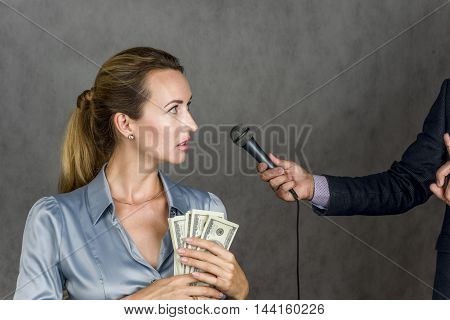 Girl with money and hand with a microphone