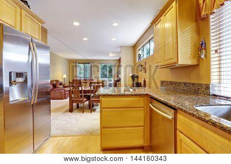 Light Tones Kitchen Interior With Modern Steel Double Doors Fridge.