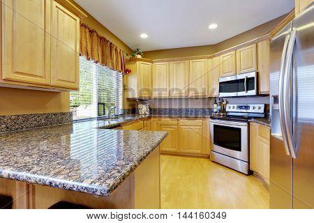 Light Tones Kitchen Interior With Modern Steel Appliances.