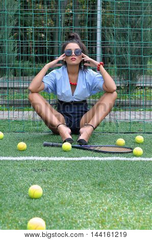 Woman Sitting Near The Net With Racket