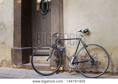 on the street, old bicycle near the entrance to the house