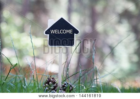 House Shaped Chalkboard sign in nature WELCOME