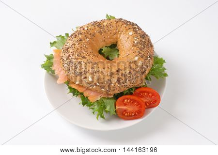 bagel sandwich with smoked salmon on white plate