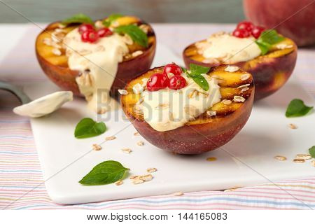 Closeup detail of delicious Grilled peaches dessert.