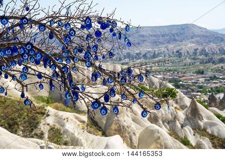 Evil eye hanging on the tree in Cappadocia valley Turkey