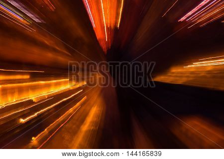 Abstract pattern of city lights from cars windows streetlights and bars