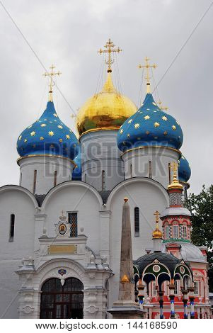 Trinity Sergius Lavra (monastery). Popular touristic landmark UNESCO World Heritage Site. Foreign text: Followed by him.