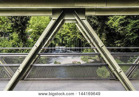green small metallic bridge structure sunny day closeup