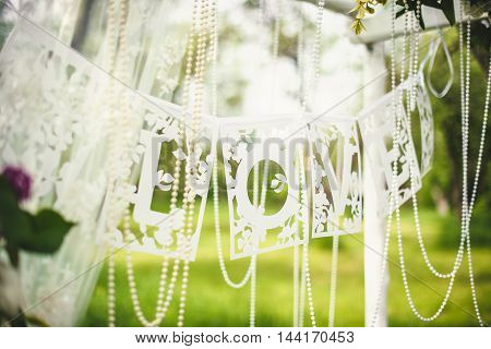 love word text paper cut hanging on wedding arc
