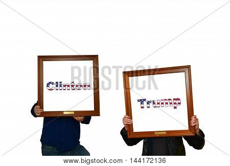 Tho mans holding picture frames with the inscription clinton-trump