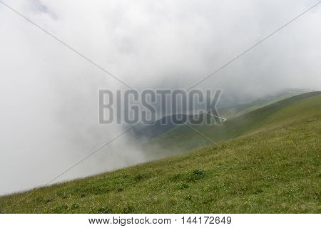 Fast moving clouds covering Monte Baldo at lake Garda (Malcesine Italy)