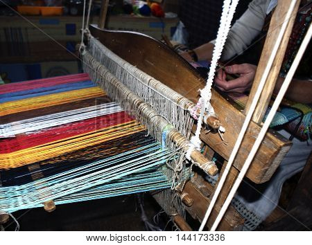weaver at work, the photo on national crafts