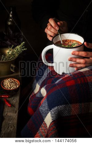 Mug With Soup In Female Hands.