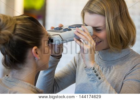 young woman trying on eyeglasses at an optician