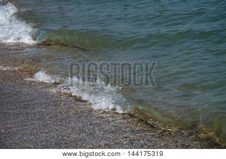 wave beach clean clear water of the Black Sea summer warm day