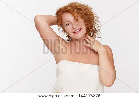Portrait of beautiful mature of middle aged woman, aged 40, looking after her hair isolated on white. Pretty senior lady looking at camera in studio.
