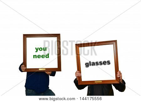 Tho mans holding picture frames with the inscription you need glasses