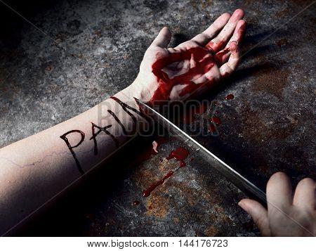 masochist woman cutting veins on hallowen night