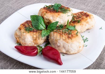 Close Up View On Rissole Of Minced Chicken On A White Plate