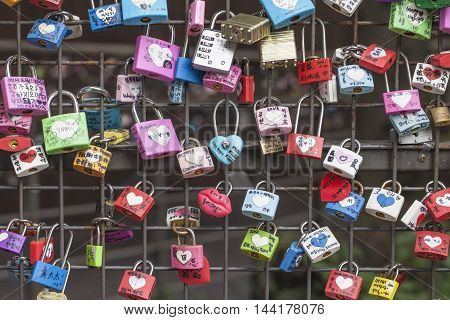 SEOUL SOUTH KOREA - AUGUST 09 2016: Locks on fence at Namsan Tower as a sign of mutual love. Shot made in Seoul South Korea on August 09 2016