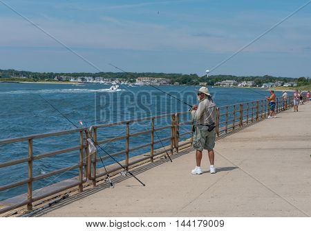 Fisherman's Cove Manasquan NJ USA-- August 24 2016 Fisherman waiting for a bite at Fisherman's Cove in Manasquan NJ