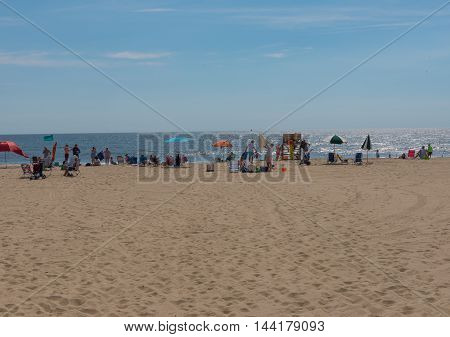 Spring Lake NJ USA -- Augsut 25 2016 -- Vacationers on the Beach at Spring Lake NJ. Editorial Use Only