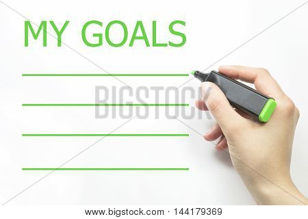 My Goals. hand and green marker. hand and green marker