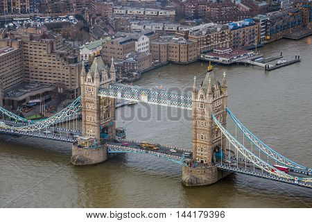 London England - Aerial view of the world famous Tower Bridge with red double decker bus