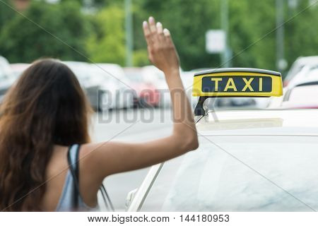 Close-up Of A Woman Calling For Taxi