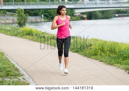 Healthy Young Athletic Woman Running In Morning