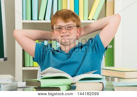 Portrait Of A Happy Relaxed Boy Taking Break From Study