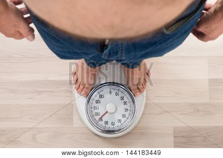 Low Section Of A Person Standing On Weighing Scale