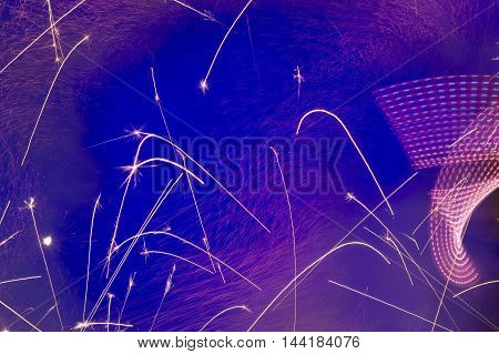 Abstract background with sparks made as a result of fireworks