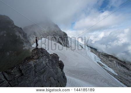 A mountain climber climbs over a glacier in BC