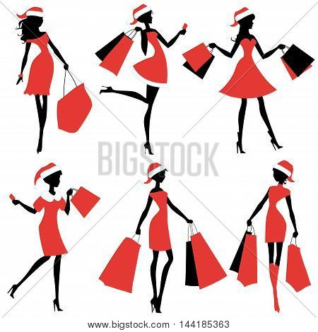 Set of silhouettes of Santa girls with bags in their hands.