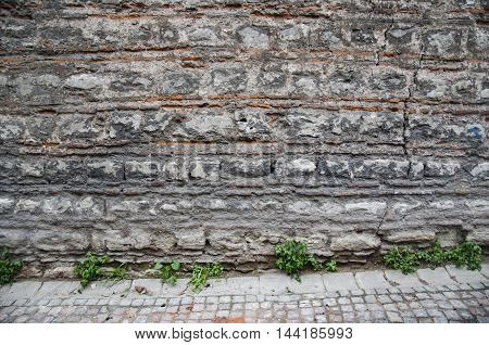 Historic stone walls Background-Texture cracked concrete vintage brick wall