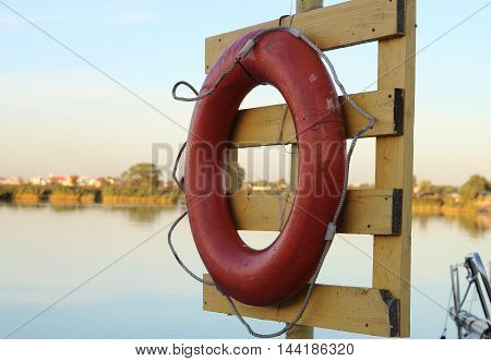 lifebuoy red on a board in port
