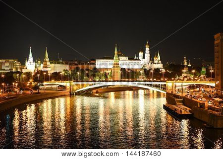 Kind to the Moscow Kremlin and Moskva River in night. Russia.