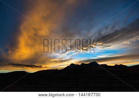 Sunset at the Cotopaxi National Park with the silhouette of Rumiñahui volcano