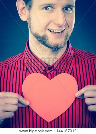 Cheerful Man Holding Heart.