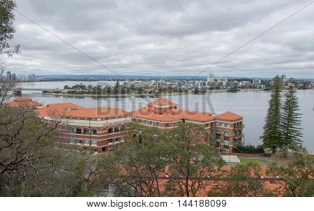 PERTH,WA,AUSTRALIA-AUGUST 5,2016: Elevated views overlooking the Swan Brewery, the Swan River and South Perth from King's Park under stormy skies in Perth, Western Australia.