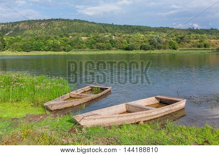 beautiful scenery with wooden boats on the riverside