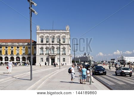 LISBON, PORTUGAL - September 30, 2015: View of the east side of the Commerce Square cruise ship and tourists visiting Lisbon on September 30, 2015 in Lisbon, Portugal