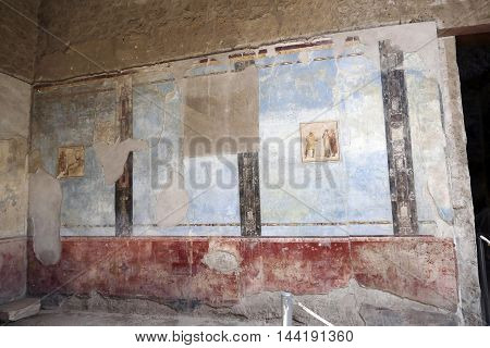 POMPEII ITALY - may 25 2016: wall paint in famous antique ruins of town Pompeii Italy. Pompeii was destroyed and buried with ash and pumice after Vesuvius eruption in 79 AD.