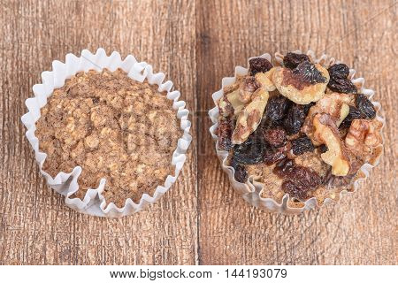 Plain muffin next to walnut raisin muffin